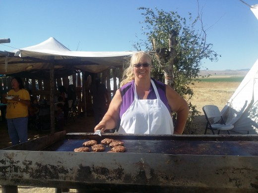 Hot sun, hot grill, good food at camp