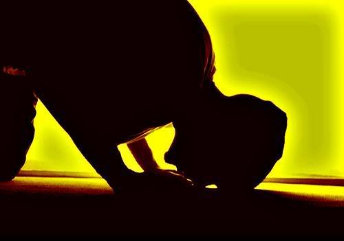 Muslim at prayer.