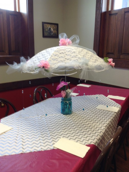 Emily's mother-in-law, Cheryle, made these adorable umbrella centerpieces from an site she saw in Pinterest!