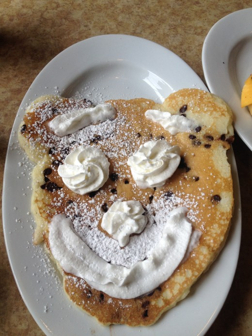 Enjoy traditional American pancakes from a real diner around the NYC area like this happy face kids pancake from the Brownstone Diner in Jersey City.