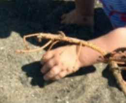 Hands learning to play in Alaskan sand!