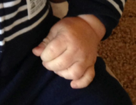 Tiny growing, birthday hands!