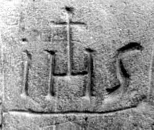 IHS with Tammuz cross representing sun god worship.