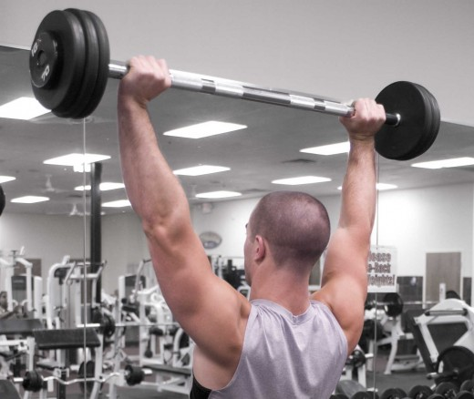 The overhead press (either standing or sitting with back support) is an excellent exercise for triceps and shoulders.