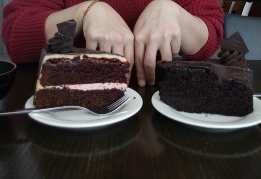 Left: Red velvet; right: chocolate mudcake. I'd say that my hands are there for size, but I actually have pretty big hands...