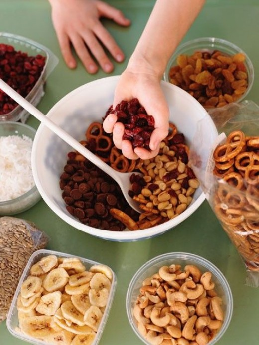 Make a snack mix out of pretzels, dried fruit, nuts, and other small foods.