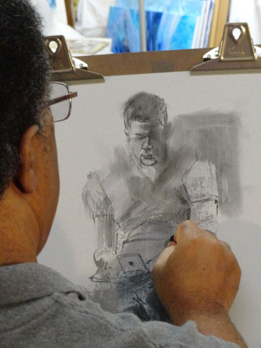 My good friend, Dennis, sketching his son Chris.