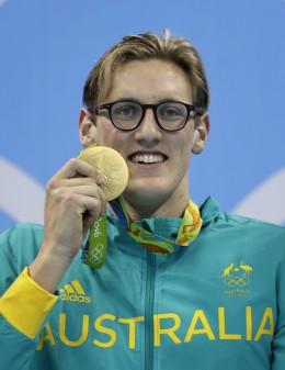 Australia's gold medal winner Mack Horton celebrates on the podium during the ceremony for the men's