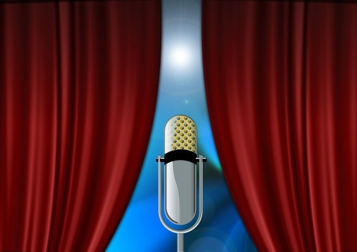 The curtains open and the microphone is prepared for the speaker.