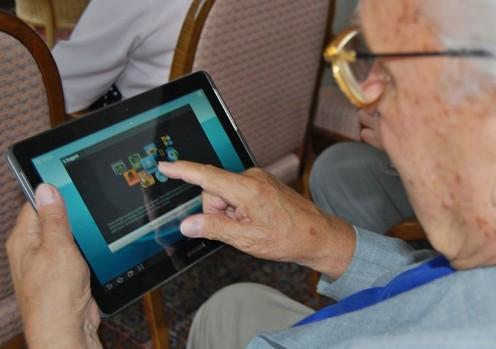 Senior using a tablet computer.