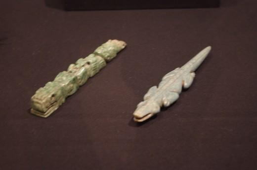 """""""Crocodile Effigy Pendant"""" Made of jadeite. Yes I know there's two in this picture but the Aztecs spoke in singular."""