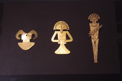 """""""Ornament"""" of Tolima (before 1500 AD). """"Figural Pendant"""" of Tolima (ca. 700-1000 AD). """"Tunjo of a Standing Man with a Miniature Raft"""" Muisca (Late IntermidiTe Period 1000-1500 AD). All made of gold, but not Chet Faker's lover."""