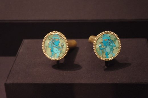 """""""Pair of Earflares"""" of Moche (Early Intermediate, 400-600 AD). Made of gold alloy, turquoise, and stone inlay. """"Earflares"""" what the hell?"""