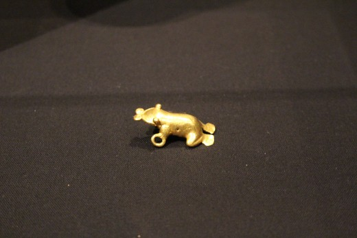 """""""Horned Frog"""" Veraguas-Gran Chiriqui (Period V-VI, 700-1520 AD). Made of gold-and-copper alloy. Definitely a frog, my sources don't have to check on that."""