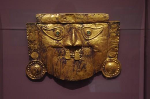 """Funerary Mask"" Sican-Chimu style. Made of gold alloy. ""Booga-booga-booga-booga!"""