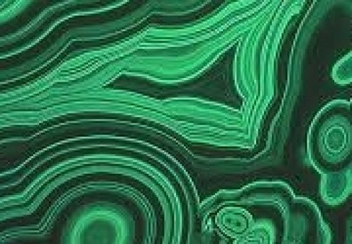 Malachite stone when polished appears as a series of green and black circular shapes.