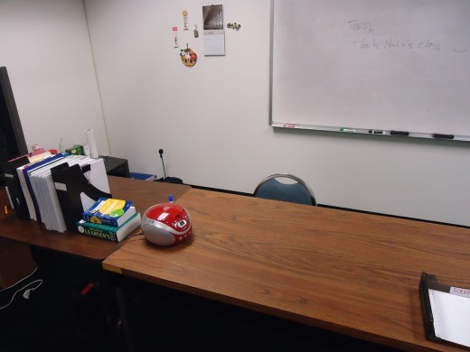 An unoccupied teacher desk.