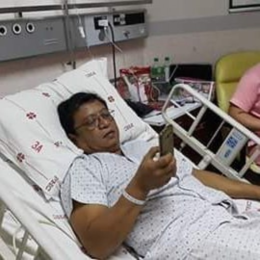 Dad texting family members before undergoing angioplasty for his heart.