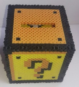 A Mario Coin Block Money box made from Perler Beads! So cool and very cleverly made.