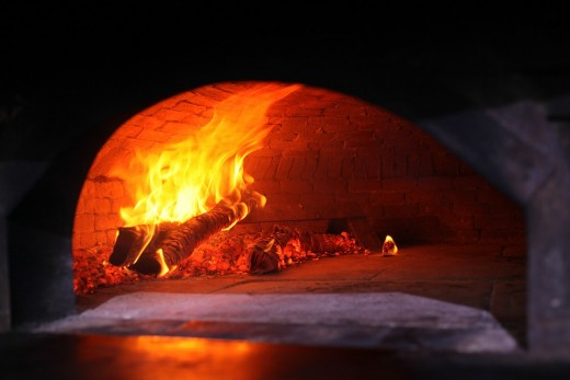 Wood fired ovens are used to cook pizza, farinata and other typical Italian dishes