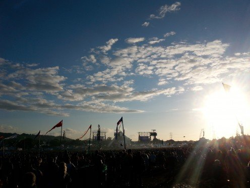 The sun begins to set on the main stage at Glastonbury festival