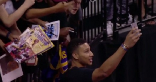Ben Simmons is chilling with the fans instead of playing basketball.