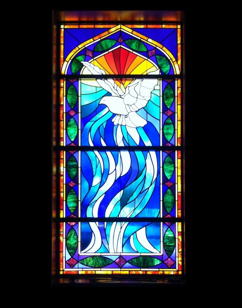 In the chapel: A beautiful stained glass window with a dove...