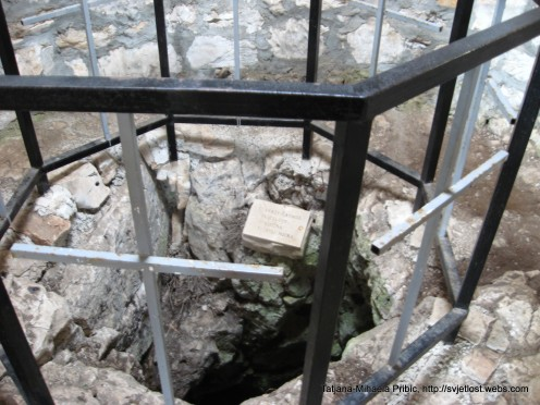 This church has one very spooky detail, it is build above the 57m (cca 170 feet) deep cave, where are found human bones - left from the World War II. Inside the church, you can see this cave protected by metal fence.