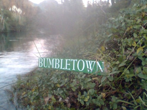 The welcome sign of Bumble Town greets you once you beat the rapids.