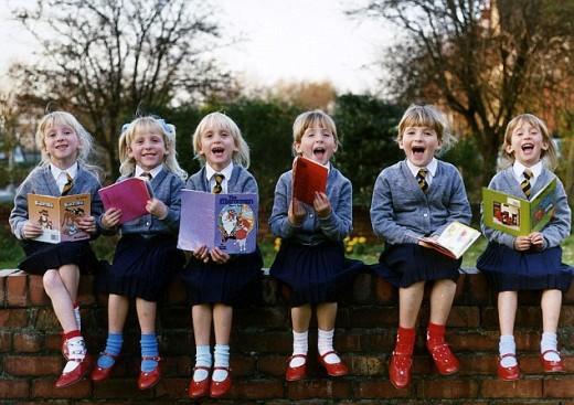The Walton girls, all six of them, born in November 1983 in England, in their school uniform.