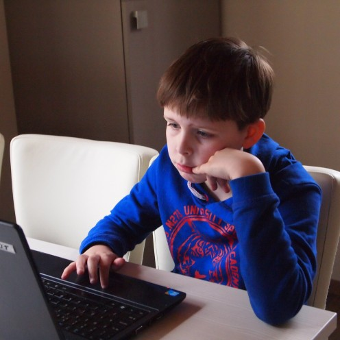 Boy searching for information online.