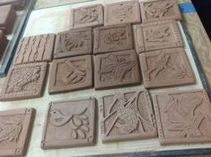 Slabs of clay in bisque state waiting to be fired.