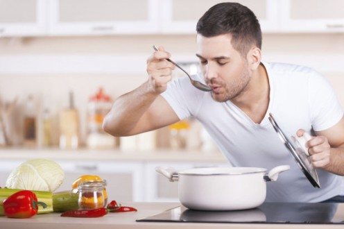 A measure of women think  a man is sexy while he is cooking