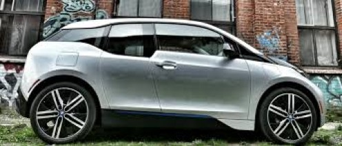The i3 is a 5-door hatchback that runs on a total electric engine for 85 plus miles before gasoline kicks in.