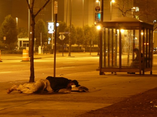 a homeless person lying on a street in Cleveland, Ohio, U.S.A.