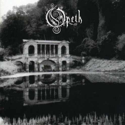 The album cover shows a lake with some grass nearby. Then there is a small structure that resembles an old style Greek building as the sky is filled with cloud cover.