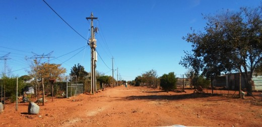 "Still dirt roads in the residential areas of mainly ""all-black"" townships, South Africans"