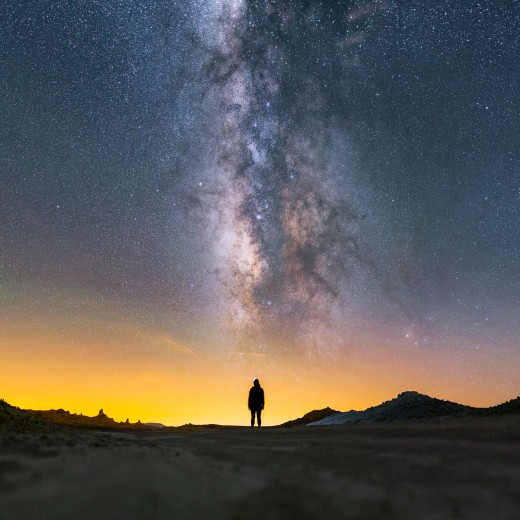Milky Way lying above a lady's silhouette, at Trona Pinnacles National Landmark, California..
