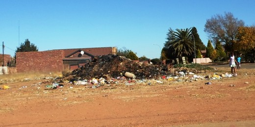 Rubbish all over, especially in black neighborhoods, due to corrupt, ineffective bancrupt municipalities, South Africa