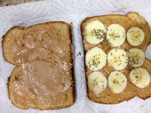 Breakfast with a peanut butter sandwich, banana, and Chia seeds sprinkled on top
