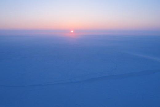 Sunrise over sea ice near the North Pole