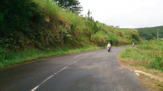 Taking the turnoff smack in the mid of the Prenne Hill, we motorcycle downhill then uphill toward the temple