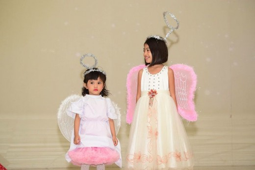 Two little girls dressed as angels.