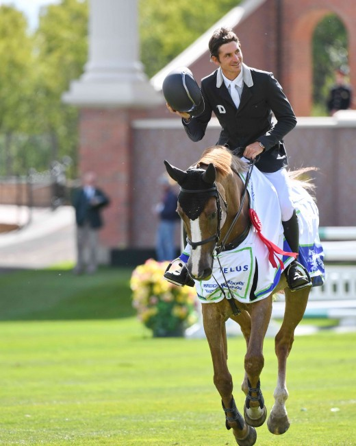 Steve Guerdat and Albfuehrens Happiness enjoying their victory lap in the Telus Cup at the Spruce Meadows Masters in Calgary Canada.
