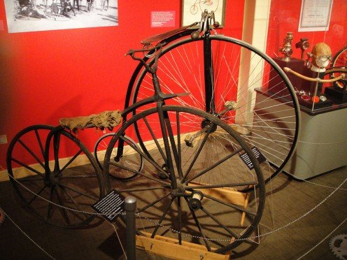 1869 Hanlon Brothers boneshaker and 1885 Victor high wheeler displayed in Colorado.