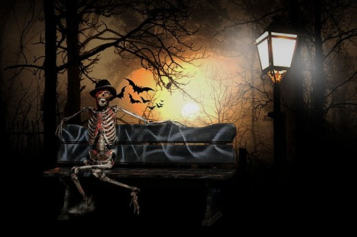 Lighting will help to create a surreal surrounding which finds a skeleton sitting on a bench beside a lamp post with black birds in the sky.