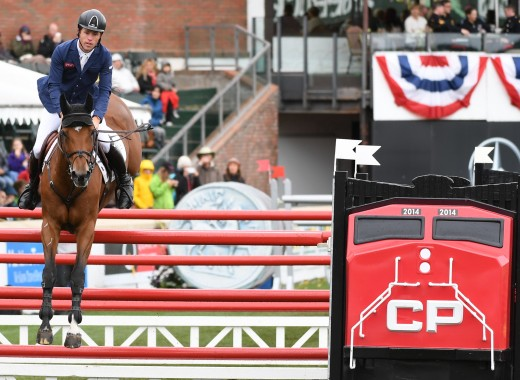 "Scott Brash negotiating Urusula XII over the CP jump at the Spruce Meadows ""Masters."""