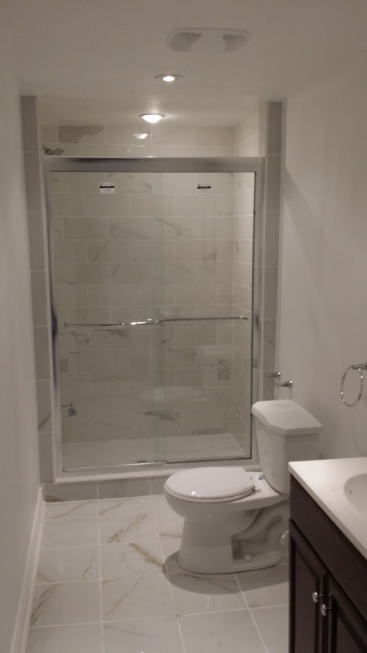 Tile on the floor and shower completes the space, with painted walls and money saved.