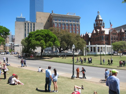 View of Elm Street from the picket fence above the grassy knoll. The School Book Depository is just off camera to the left.