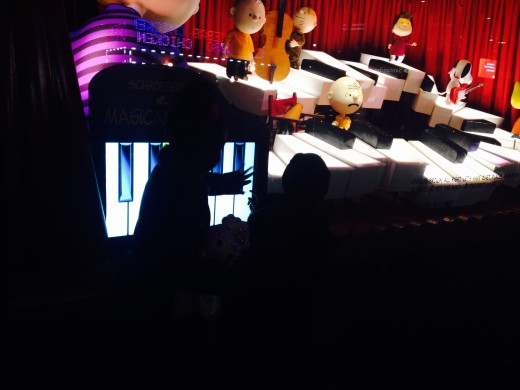 Kids enjoying the interactive piano from Macy's 2015 holiday windows--a great free thing to do in NYC over Christmas.